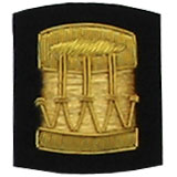 Embroidered Gold wire on black cloth drum insignia badge