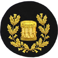 Embroidered Gold wire on black cloth wreathed drum Drum Major insignia badge