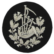 Embroidered Silver wire on black cloth wreathed bagpipes Pipe Major insignia badge